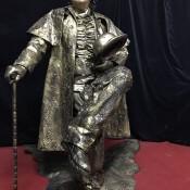 Sitting living statue